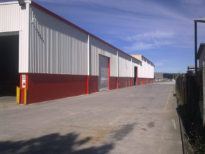 Large Red & White Painted Exterior Industrial Building - Industrial Painting Brisbane, Gold Coast & Sunshine Coast